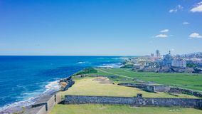 View of lawn and city skyline by blue sea in old San Juan, Puerto Rico stock images
