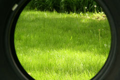 View of lawn through a tire Royalty Free Stock Photography