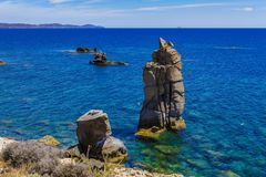 View of Le Colonne of Carloforte Island of San Pietro, Carbonia. Marine panorama of the volcanic rock pillars called Le Colonne near Carloforte Island of San Royalty Free Stock Photo