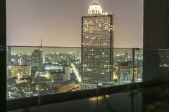 View on lebua state hotel at night from infinity pool, Bangkok Stock Image