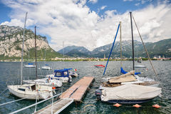 View of Lecco, Italy, with boats at foreground Royalty Free Stock Images