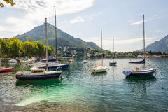 View of Lecco, Italy, with boats at foreground Stock Photos