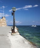 View of left side of Chania harbour entrance Stock Photo