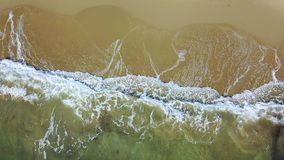 View from the left to the right to water touches the land. Aerial survey. View from the left to the right on sea water touches the land of foamy white waves stock video footage