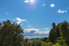 View on Leman lake. Swiss. View on beautiful lake Leman from park in down town with big cloud and wonderful sky. City of Lausanne, canton Vaud, Switzerland Stock Image