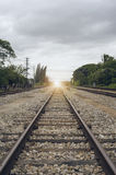 View of the length of railway with green tree at left and right side of railway,filtered image, light effect and flare added Royalty Free Stock Image