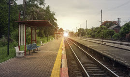 View of the length of railway with pavement at left side of railway,filtered image, light effect and flare added,selective focus. Mean Theres light at the end stock photo