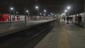 View of Leningradskiy railway staion in the evening with people rushing to trains stock video