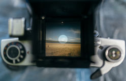 The view through the lens of an old camera. Stock Photos
