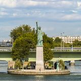 Liberty Statue copy in Paris, France. View of Liberty statue copy on island in Paris with view of city on background royalty free stock photography