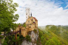 View of the Lichtenstein Germany castle in clouds Stock Photos