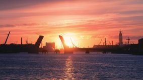 View of the lifted bridge across the Neva at sunset stock video footage