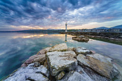 Sunrise at lake in the Cityscape Stock Image