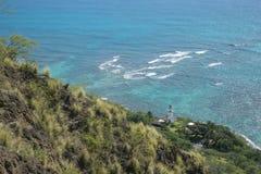 View of lighthouse below Diamondhead O`hau Hawaii Stock Photography