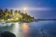 View of lighthouse Dondra Matara, Sri Lanka. View of lighthouse Dondra and lights at night Matara, Sri Lanka stock photography
