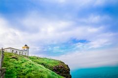Lighthouse by Duncansby Head in Scotland. View on lighthouse by Duncansby Head in Scotland Stock Photography