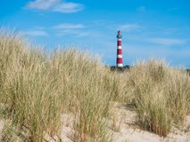 View on lighthouse in the dunes of Ameland, Holland Stock Photo