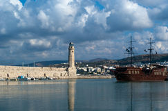 View of lighthouse in Harbor of Rethymnon. Venetian lighthouse and pirate ship in the Venetian Harbor Of Rethymnon (Crete, Greece Royalty Free Stock Images