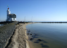 """View on the lighthouse of Marken, the Netherlands. The old lighthouse of Marken, named  """"the Horse of Marken""""  is still there as a landmark and a memory of Stock Photo"""
