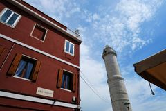 View on the lighthouse on Murano Island form Bressagio street stock photography