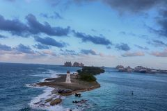 View of lighthouse in Nassau, Bahamas and cruise ships  in the c Royalty Free Stock Image