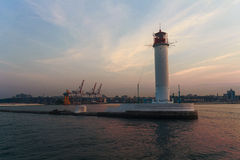 View of the lighthouse and the port at sunset Royalty Free Stock Photos