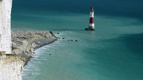 View of the lighthouse, rocky shore and the chalk cliff stock footage