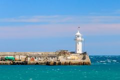 A view of the lighthouse in Yalta. Port. Crimea. Royalty Free Stock Image