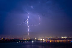 View of a lightning over city at night.  Royalty Free Stock Photos