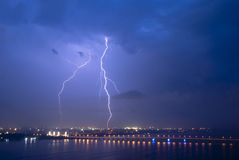 View of a lightning over city at night.  Royalty Free Stock Image