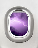 View of lightning storm from airplane window - turbulence Stock Photos