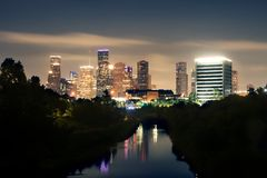 View of the lights of night Houston from the bridge over the Buffalo Bayou River. Reflections of buildings in the water.  royalty free stock photography