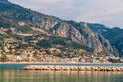 View of Ligurian Alps and Menton city from the Mediterranean Sea. France Royalty Free Stock Photos
