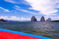 View of limestone karsts from boat. View of limestone karsts from long-tail boat in Phang Nga Bay in southern Thailand Stock Photo