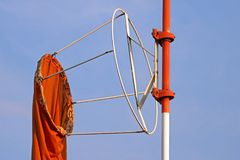 WINDSOCK HANGING LIMP. View of limp orange windsock in windless conditions on a n airfield Stock Photography