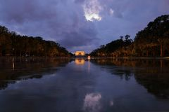 View of Lincoln Memorial and its reflection in Reflection pool at night with dramatic sky. stock photo