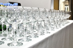 View on line of many wine glasses. On table Royalty Free Stock Photography
