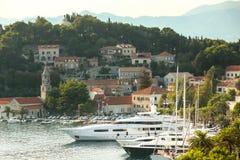 Yachts anchored at Cavtat seaside. A view of lined up yachts anchored in front of seaside in Cavtat, Croatia royalty free stock photos