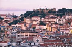 View of Lisbon in the evening with St Jorge Castle on hill Royalty Free Stock Photo
