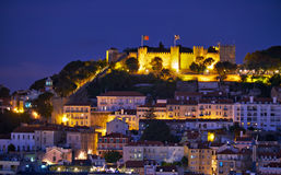 View of Lisbon in the night with St Jorge Castle Stock Photos
