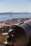 View on Lisbon with old metal cannon trunk Royalty Free Stock Photos