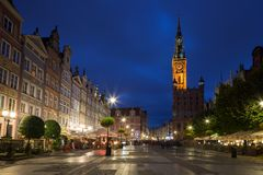 Long Market and Main Town Hall in Gdansk at dusk. View of the lit Main Town Hall and other old buildings at the Long Market, end of the Long Lane, at the Main Royalty Free Stock Photography