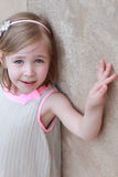 View of little girl points at wall Stock Photo