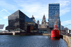View of Liverpool's historic waterfront. LIVERPOOL, UK - JULY 27, 2016: View of Liverpool's historic waterfront with modern and old architecture stock images