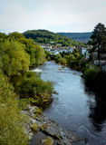 View of Llangollen. Vertical view of the river in Llangollen in Wales with the town and hills in the background stock photo