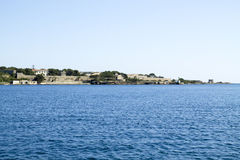 View of Llatzeret Island from the coast of the town of Es Castell Royalty Free Stock Photos