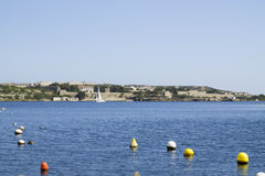 View of Llatzeret Island from the coast of the town of Es Castell Stock Photography