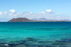 View of Lobos island from Beach in Corralejo, Fuerteventura Royalty Free Stock Photo