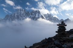 View of Lobuche Peak from Kala Patthar, Solu Khumbu, Nepal. View of Lobuche Peak from Kala Patthar above clouds, Solu Khumbu, Nepal Royalty Free Stock Images