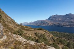 View of Loch Maree and mountain Slioch from a mountain trail. View of Loch Maree and mountain Slioch from the mountain trails in Beinn Eighe Nature Reserve Royalty Free Stock Photos